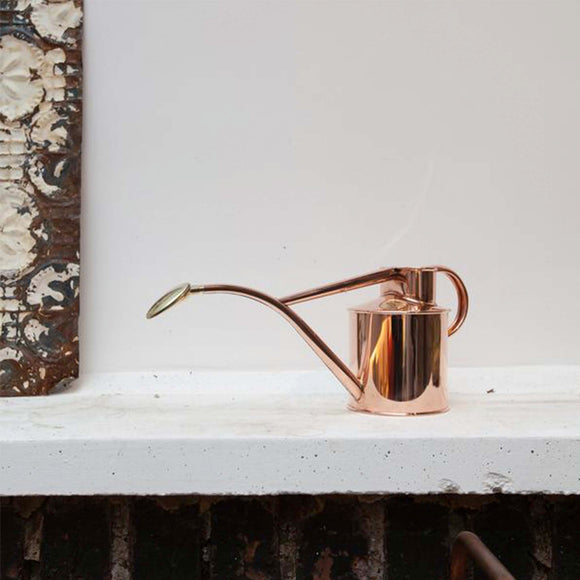 Striking and functional copper watering can.