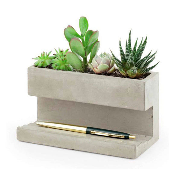 Large desk planter, ideal for succulents. Made from solid concrete it's the perfect statement yet practical piece for any workplace.