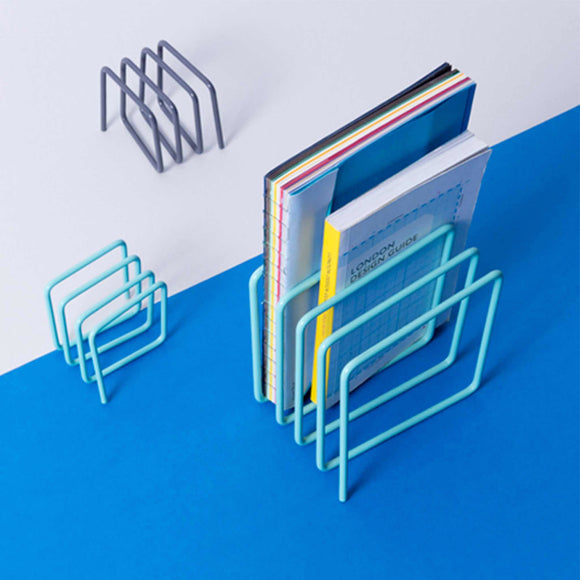 One piece of metal looped to form a trendy magazine rack.