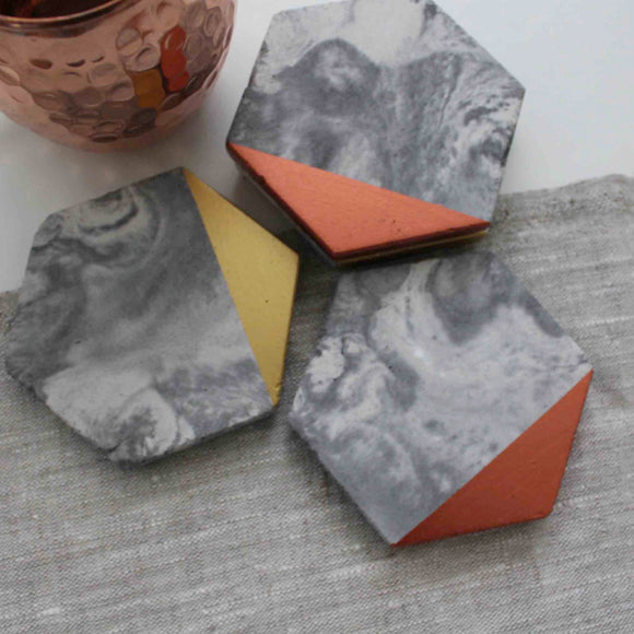 Hand Poured concrete coasters, add the perfect geometric touch to your coffee table or workstation.