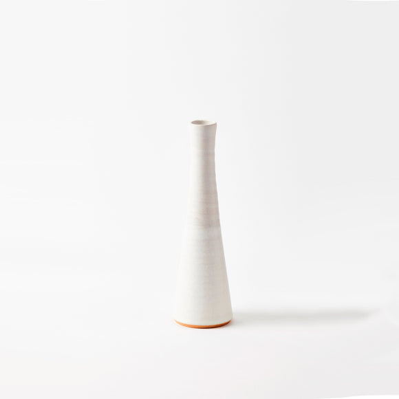Nordic landscape inspired ceramic handcrafted medium sized snow stem vase. With an attractive white finish it is a beautiful addition to any workspace.
