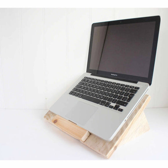 Handmade from reclaimed pallet wood, this reclaimed wooden laptop stand makes the perfect mount to place a laptop or book on for comfortable use.