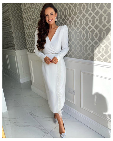 white vivienne feather trim dress with puff sleeves and waist embellishment