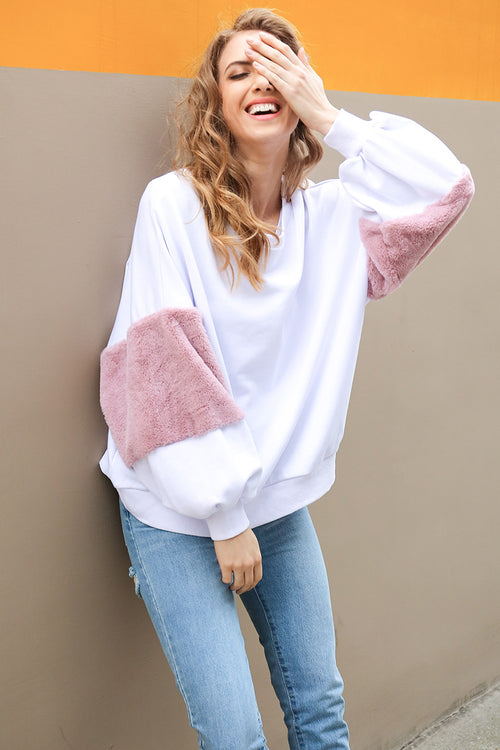 white oversized pullover with faux fur sleeve details