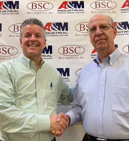 David Young, President of A&M Industrial with Stanley Romanek of Boro Supply