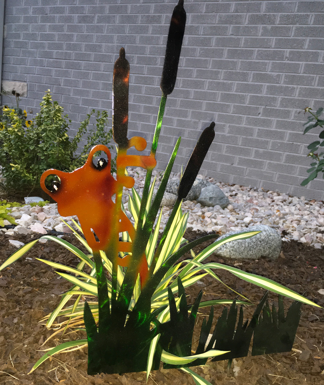 Metal pond artwork, orange frog peeking through the cattails.  Created by Forged From The Ashes Metalworks & Design Inspirational Artwork