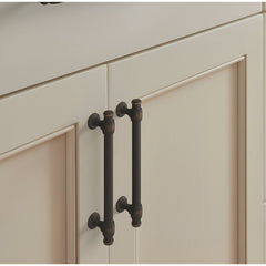 oil rubbed bronze cabinet pulls on a white cabinet