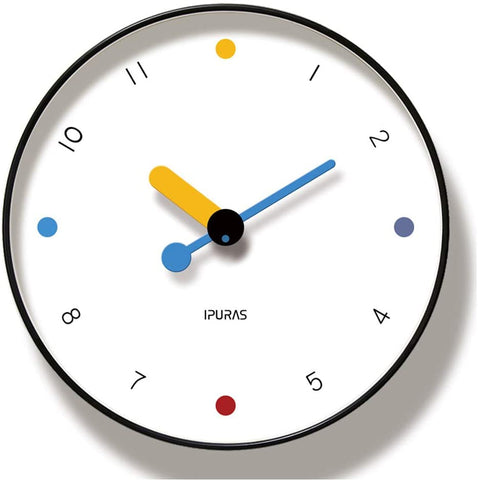 Contemporary looking white clock, with red, blue and yellow accents, the only numbers not shown are 12, 3, 6 and 9, they are shown with colored dots