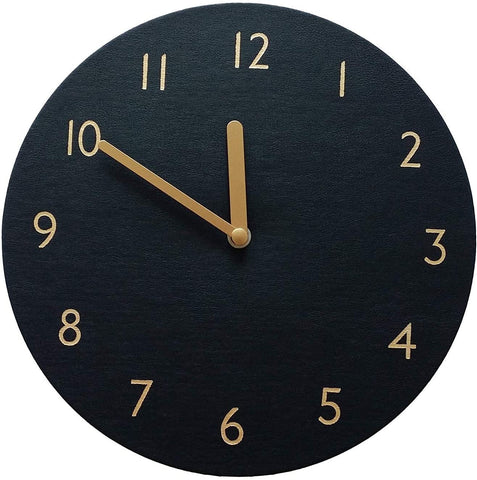 Black leather clock, no frame, numbers are block like and gold, hands are gold.