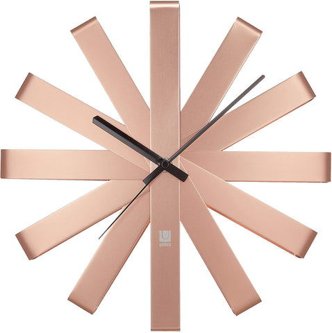 Light pink metal pieces in a star burst formation, simple black thin hands, no numbers