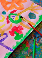 Close up of a child's painting done in bright paint colors.