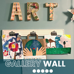 """Wall with the word, """"Art"""" and below it are 3 hung pieces of children's art."""