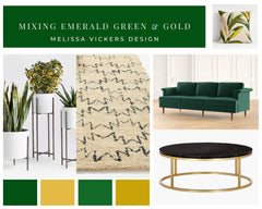 3 plants, rug, green sofa and black and gold coffee table