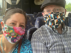 Image of me and my husband wearing masks on the charter bus.