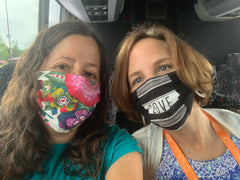Photo of me and my friend Michelle on the bus, both wearing masks.
