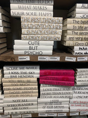 Books that have been wrapped with fun quotes on the spines.