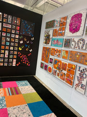 Stephen Wilson art on the walls, and fun multi-colored carpet tiles on the floor.