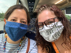 Photo of me and Marissa wearing masks on the charter bus.