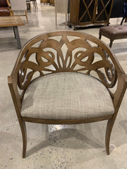 Accent wooden chair with a cool design cut out of the back.