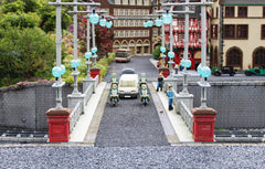 Image of a Lego city, a bridge with a motorcade crossing it, makes one think of London.