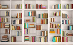 Wall of white bookcases filled with multi-color books