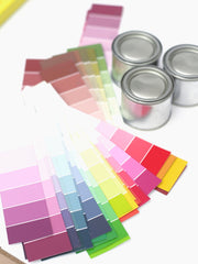 Paint swatches and 3 cans of paint
