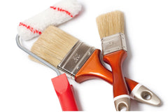 Two paint brushes and a roller, all are clean.