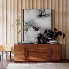 Wooden living room side board decorated with vase and twigs
