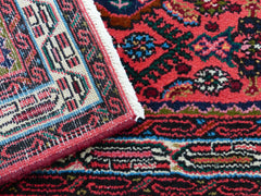 Oriental rug with bold colors such as reds and blues
