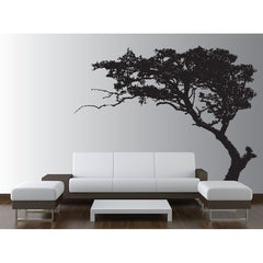 Black and white design living room with a black tree decal on the back wall.