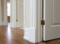 View of door and wall trim from the floor.