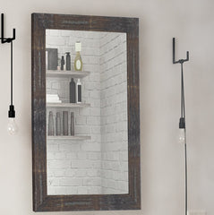 Natural wood frame mirror in a bathroom