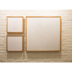 3 blank frames one a painted brick wall