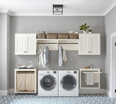Laundry room with a lot of cabinet storage