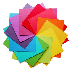 Square pieces of paper all different colors arranged in a circle