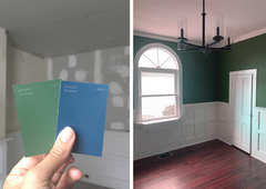 Left side of image shows a hand holding 2 paint chips, one green and the other navy.  The other half of the photo is of an empty dining room painted in the green color.