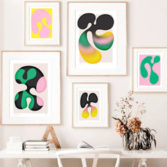 Gallery wall art of funky organic designs in pinks, greens and black.