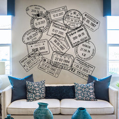 Image of a sofa with a wall behind it full of large passport wall decals.