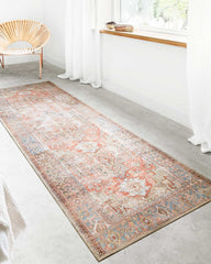 loloi terracotta sky rug runner in front of a white window.