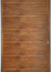 Close up image of a wood panel door.