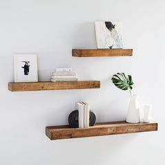Reclaimed wood floating shelves with decorative items on them.
