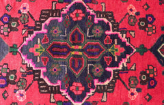 Close up of a rug medallion in pink