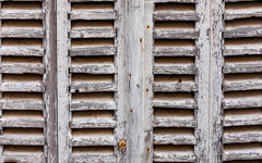 close up image of weather beaten shutters