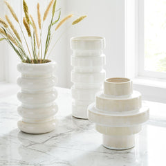 white ceramic geometric vases from west elm on a table
