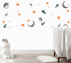 White wall with rocket ships, moons and stars wall decals