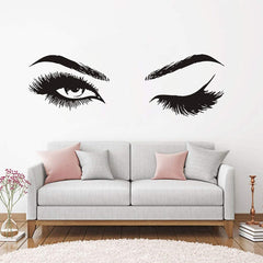 Sofa with large woman's eyes above, one eye is open, the other is winking.