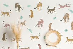 Wall with different colored leopard wall decals on it.