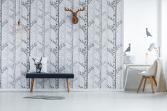 Tree wallpaper with deer decoration accents.