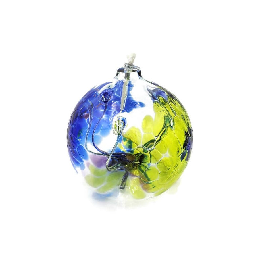 Round, blown glass orb with wick for burning oil. Clear glass with swirls of blue and apple green plus accents of purple