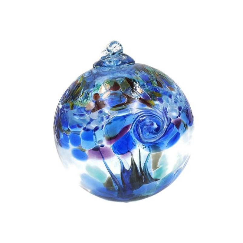 Hand-blown clear glass hanging ball ornament with a blue feature swirl and  accent colors of blue, purple, white, and green.
